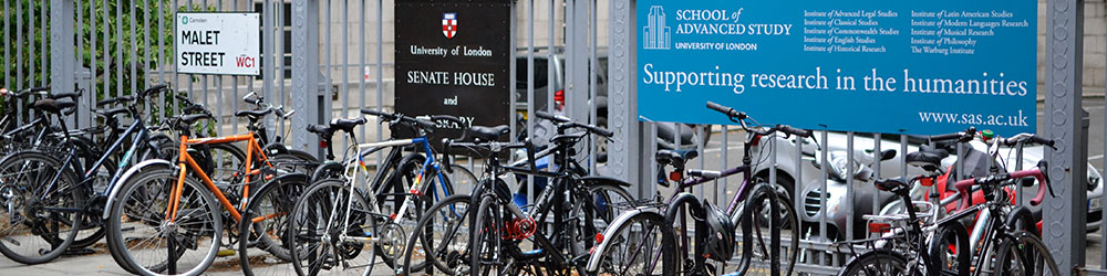 Bikes at the front fence of Senate House